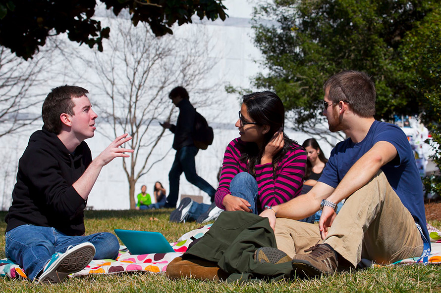 students conversing on campus