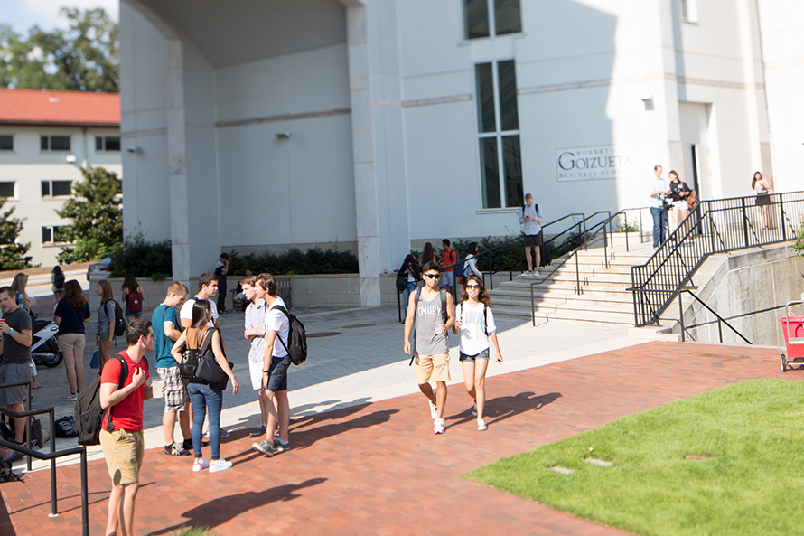 students outside of Goizueta buildings