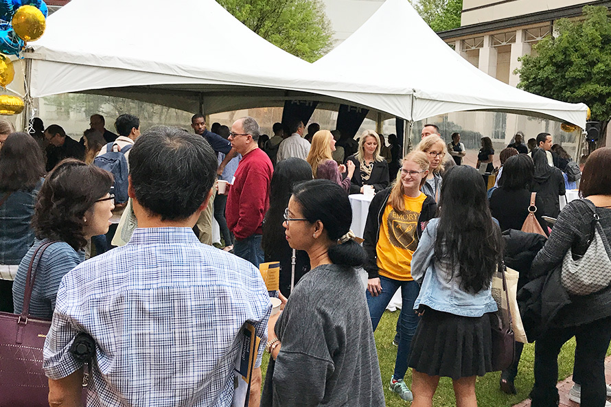 high school students and families enjoy the Spring Into Emory Open House