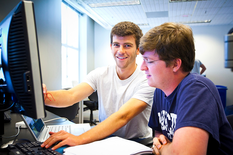 Two male students at computer